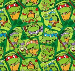 SPRINGS CREATIVE PRODUCTS NINJA TURTLES ON GREEN COTTON FABR